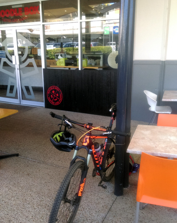 Cycling to Noodle Box for lunch