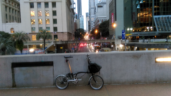 Brompton bike overlooking Adelaide St Brisbane