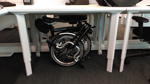 Folding bicycle under a desk