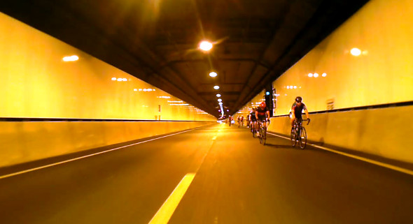 Racing through the Legacy Way tunnel on the Tour de Brisbane