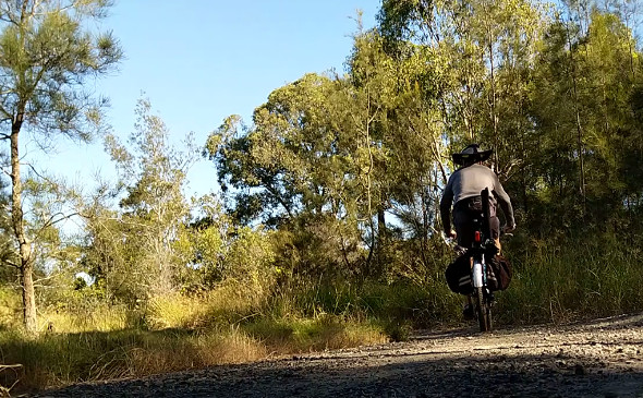 Mountain bike fishing trip rear view