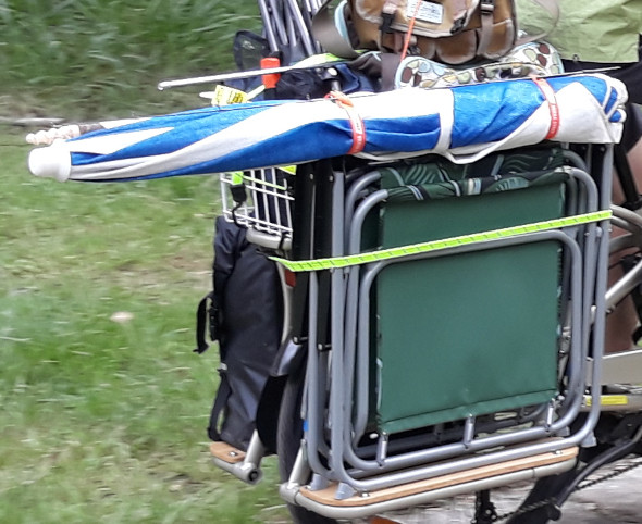 Folding chairs and umbrella on a cargo bike